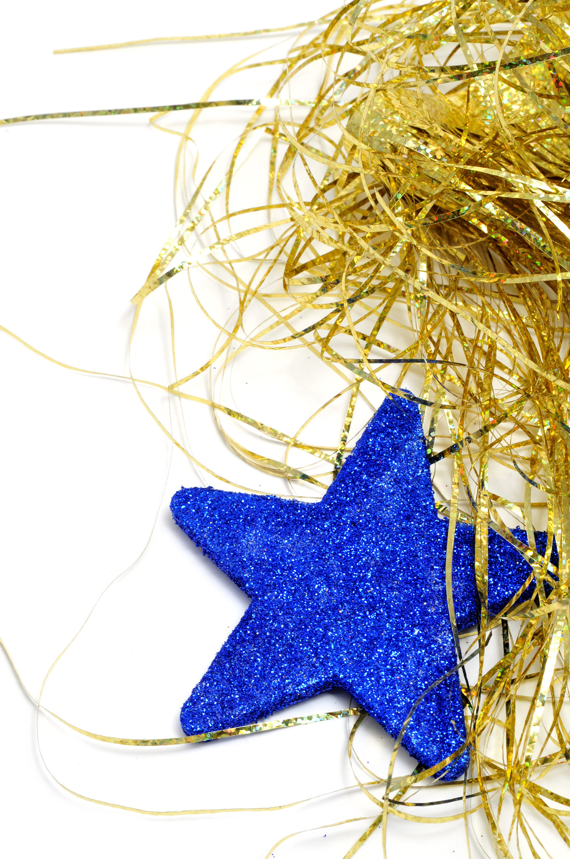 a blue christmas star and golden tinsel on a white background